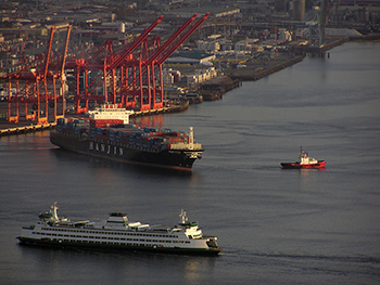 A container ship docks at the Port of Seattle WA, USA